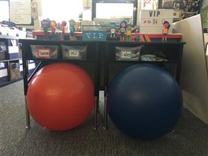 Yoga balls under classroom desks
