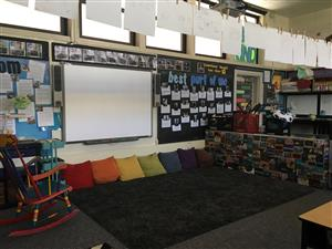 Floor pillows as seats in classroom