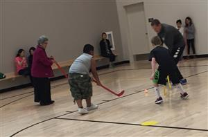 Laurel students and parents play hockey together