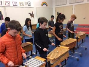 Kids learn xylophone in Orff class